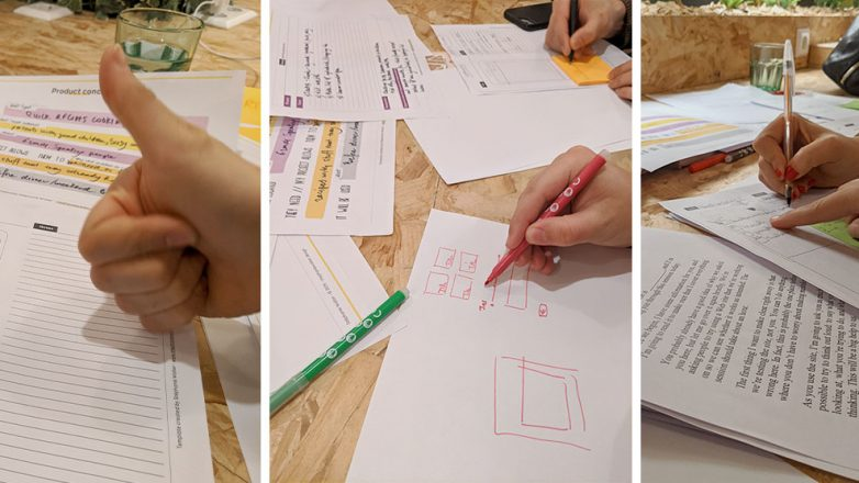 People during the workshop drawing paper wireframes, testing the concept